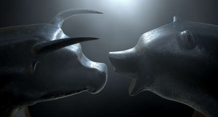 Two metal statuettes depicting a stylized bull and bear in dramatic light representing financial market trends on a dark studio background - 3D render
