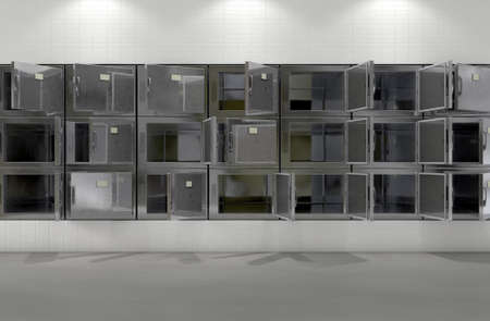 A flat wall of randomly opened fridges in a clean white ward in a mortuary - 3D render Stok Fotoğraf