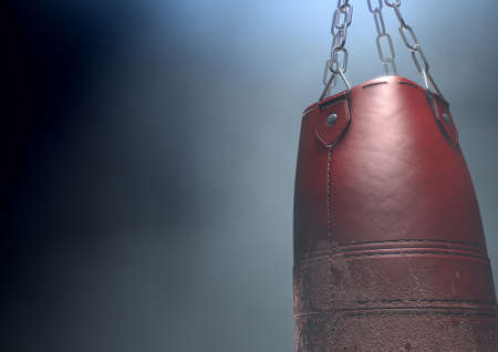 An old worn red leather punching bag hanging by chains in a dark room lit by an ethereal spotlight - 3D render