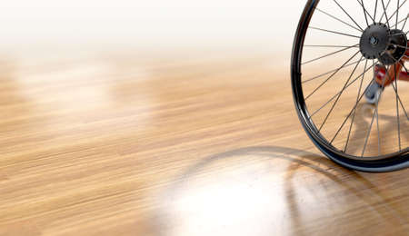 An empty modified wheelchair used by handicapped athletes to compete in various sporting codes on a polished wooden floor background - 3D render