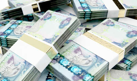 A pile of randomly scattered bundles of UAE Dirham banknotes on an isolated background - 3D render Imagens