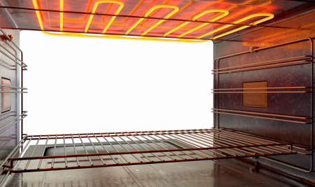 A cross section upclose view from inside an empty hot operational household oven looking out the open door - 3D render Imagens