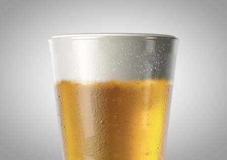 A closeup of the top half of an ice cold shaker pint shaped beer glass filled with beer and a head of foam on an isolated white background - 3D renders