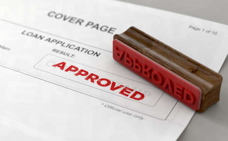 A wooden stamp with embossed text stamping the word approved on a loan application form - 3D render Reklamní fotografie
