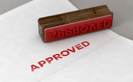 A wooden stamp with embossed text stamping the word approved on a form - 3D render