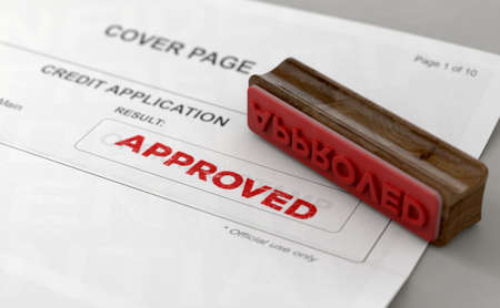 A wooden stamp with embossed text stamping the word approved on a credit application form - 3D render Reklamní fotografie