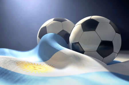 Two regular stitched panel soccer balls resting on a draped Argentina flag on an isolated dark studio background - 3D render