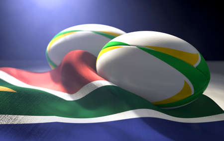 Two regular rugby balls with color design elements resting on a draped south africa flag on an isolated dark studio background - 3D render
