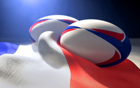 Two regular rugby balls with color design elements resting on a draped france flag on an isolated dark studio background - 3D render