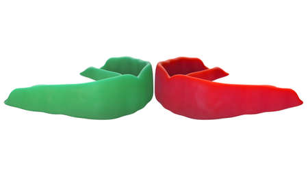 Two regular molded sports gum guards in different colors opposing each other on an isolated background - 3D render 스톡 콘텐츠