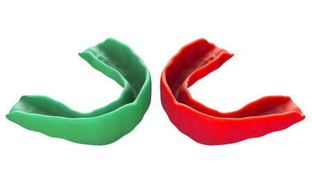 Two regular molded sports gum guards in different colors opposing each other on an isolated background - 3D render