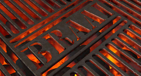Burning hot coal in a barbecue stand covered by an iron grill with the word braai cut out of it - 3D render 스톡 콘텐츠