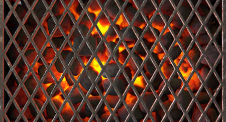 A direct top view of burning hot coal in a barbecue stand covered by diamond patterned iron grill - 3D render 스톡 콘텐츠