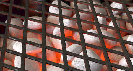 A direct top view of burning hot coal and white ash in a barbecue stand covered by diamond patterned iron grill - 3D render 스톡 콘텐츠
