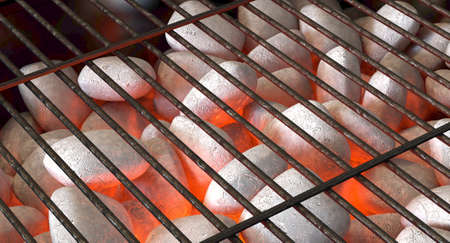 A direct top view of burning hot coal and white ash in a barbecue stand covered by a regular iron bar grill - 3D render 스톡 콘텐츠