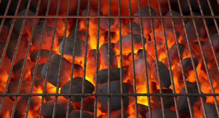 A direct top view of burning hot coal in a barbecue stand covered by a regular iron bar grill - 3D render Stock Photo