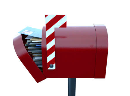 A christmas concept depicting a red retro mailbox belonging to santa clause crammed full of childrens wish list letters to him on an isolated white background - 3D render