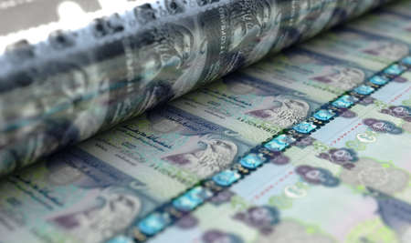 A concept image showing a sheet of Dubai Dirham notes going through a print roller in its final phase of a print run - 3D render