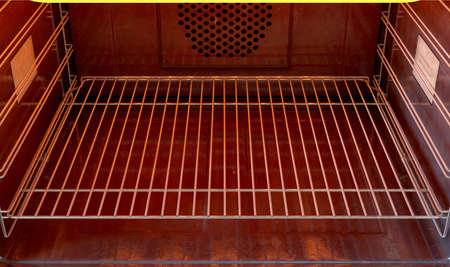 A close view inside an empty hot operational household oven - 3D render
