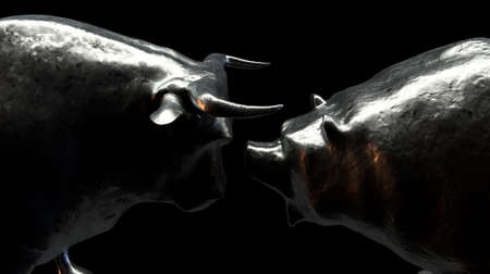 Two metal castings depicting a bull opposing a bear in dark dramatic light representing opposing financial market trends - 3D render