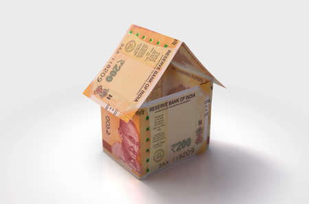 A concept of indian rupee bank notes folded into the shape of a simple house on an isolated background - 3D render
