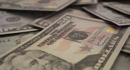 A close-up view of a scattered pile of US dollar banknotes - 3D render
