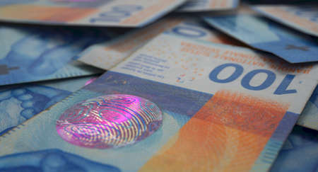 A close-up view of a scattered pile of swiss franc banknotes - 3D render Standard-Bild