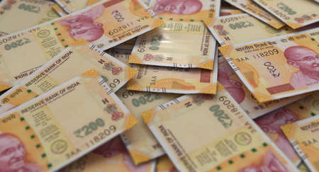 A close-up view of a scattered pile of Indian Rupee banknotes - 3D render