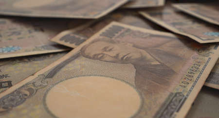 A close-up view of a scattered pile of japanese yen banknotes - 3D render Imagens