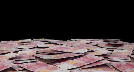 A close-up view of a scattered pile of chinese yuan  banknotes - 3D render