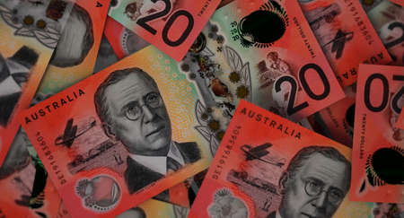 A close-up view of a scattered pile of australian dollar banknotes - 3D render