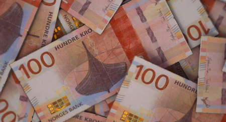 A close-up view of a scattered pile of norwegian kroner banknotes - 3D render