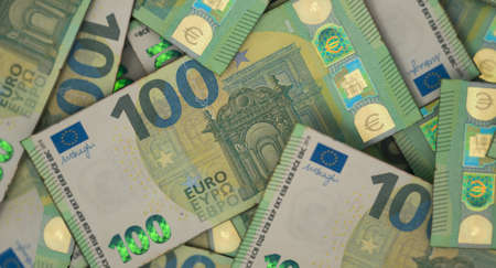 A close-up view of a scattered pile of European Euro banknotes - 3D render