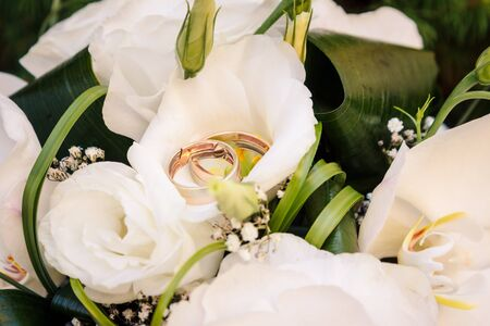 Wedding rings on the wedding bouquet.