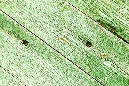 Old painted wooden fence. Background texture