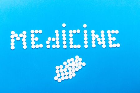 The inscription medication made of pills on a blue background