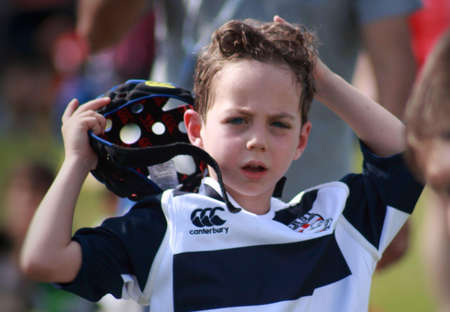 taking a break: Child taking a break During rugby match