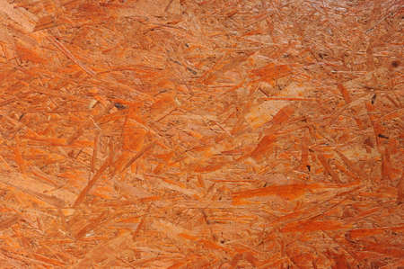 OSB boards are made of brown wood chips sanded into a wooden background