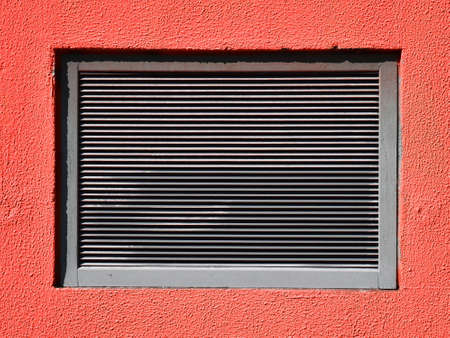 vents: Vents-hole in a red wall