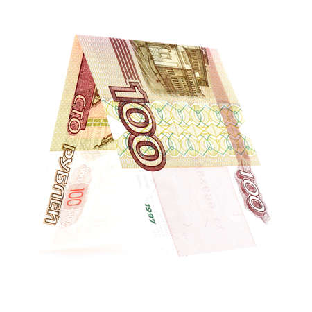 constancy: One hundred rubles folded in half, russian roubles, isolated white