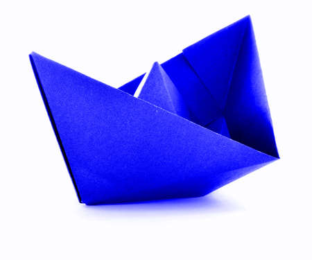 navy blue background: Blue paper navy origami sail boat, isolated on white background Stock Photo
