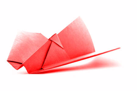 paper craft: Red origami aircraft, paper plane model, isolated on white background Stock Photo