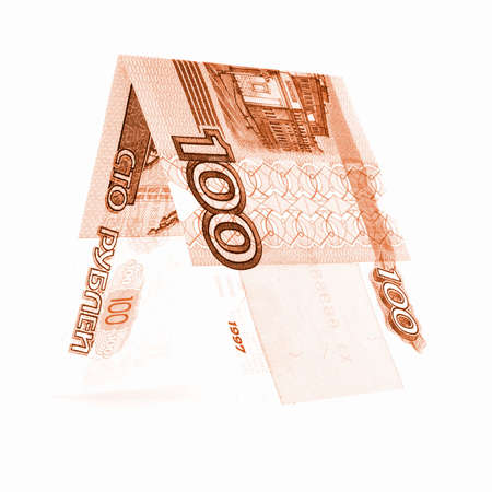 roubles: Orange hundred rubles folded in half, russian roubles, isolated whitev