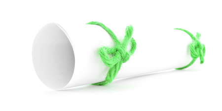 missive: White letter roll tied with cord, green knots pair, isolated