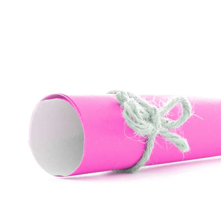 missive: Handmade natural cord bow tied on pink message roll, isolated Stock Photo
