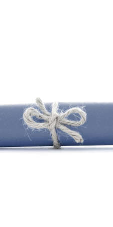 missive: Handmade natural cord knot tied on blue letter roll, isolated