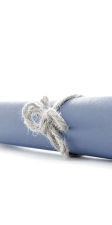 missive: Handmade natural cord node tied on blue letter scroll, isolated