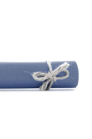 natural rope: Handmade natural rope bow tied on blue letter scroll, isolated