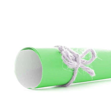 missive: Handmade natural string bow tied on green letter tube, isolated Stock Photo