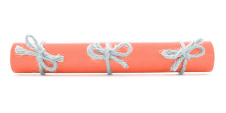 missive: Orange paper tube tied with cord, three natural knots, isolated